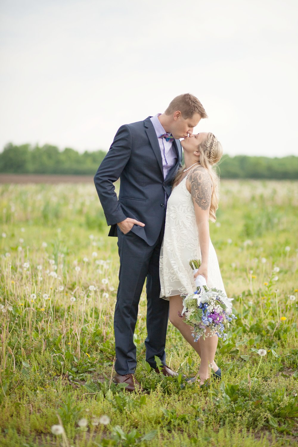 """""""Dani was so great to work with! Our pictures were beautiful - she made us look like we had just stepped out of a bridal magazine! My husband does not like having his picture taken and she made him feel very comfortable! We would definitely recommend Dani to anyone looking for a photographer and we will definitely go back to her in the future!""""- Caitlin & Jacob"""