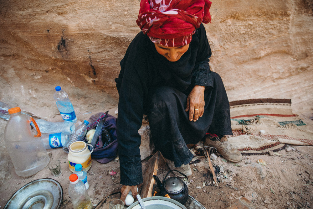 She's lived here in Petra her whole life. She was cooking eggs on the side of the trail!
