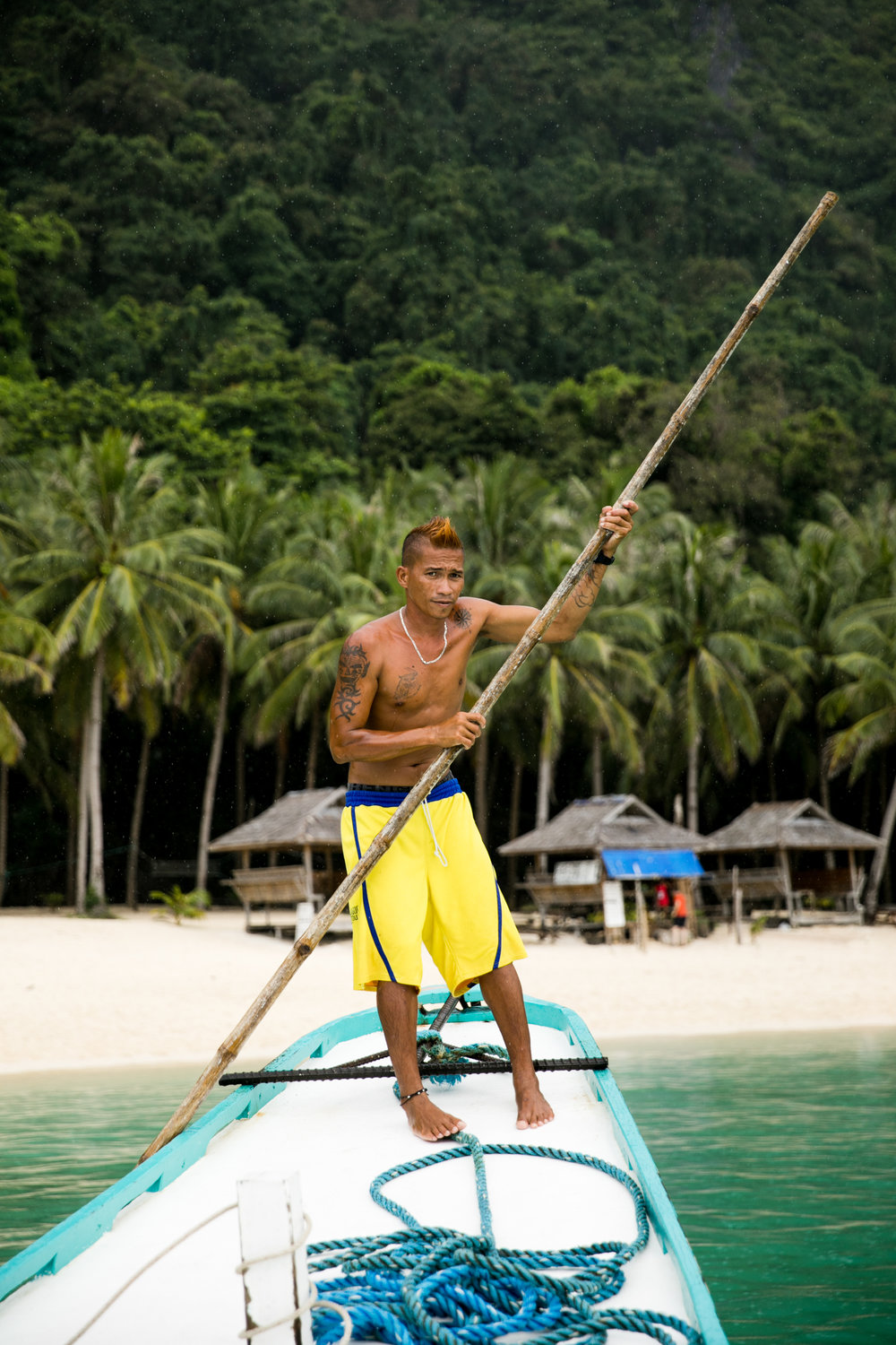 A man pushing our boat in Palawan.