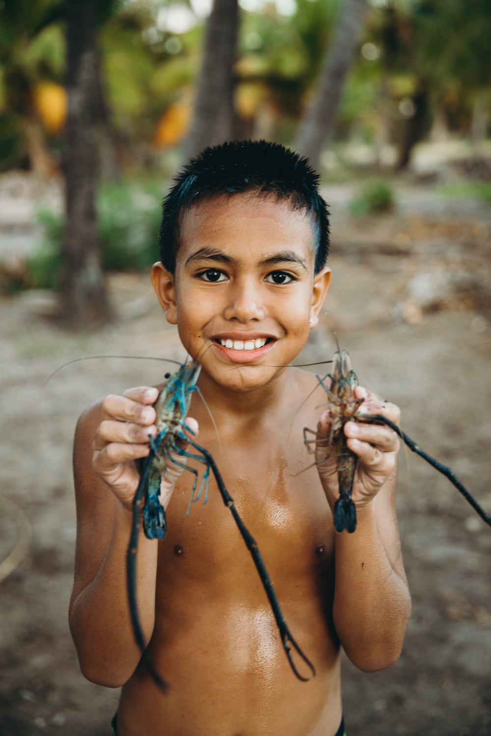 A little boy showing off his catch in Moloka'i!
