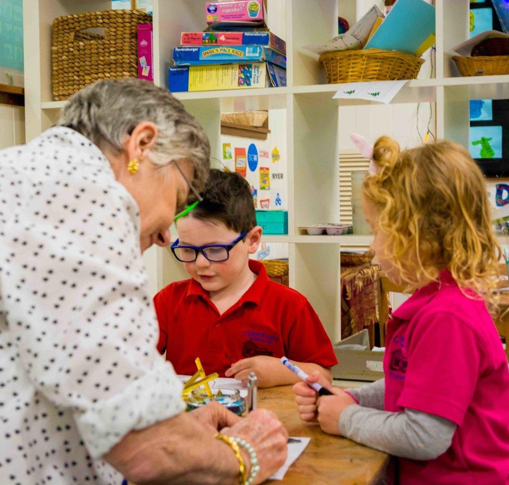 Chiselhurst_Educator at table with children.jpg