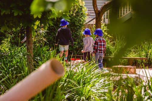 Boys exploring Chiselhurst leafy gardens