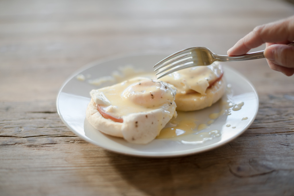 fork with eggs benedict