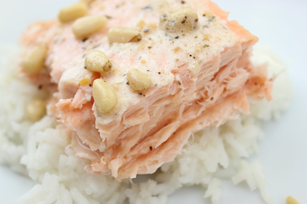 Salmon with garlic butter and pine nuts.......such a delicious and fun new twist on a regular salmon fillet. It doesn't get much easier than this!! thefoodnanny.com