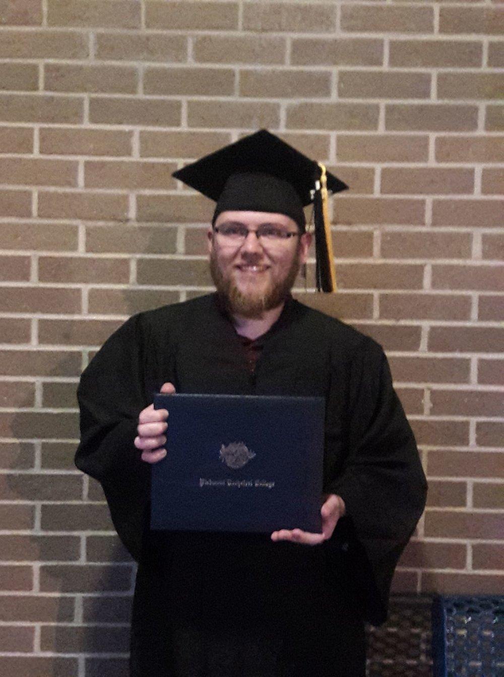 My happy self at graduation.