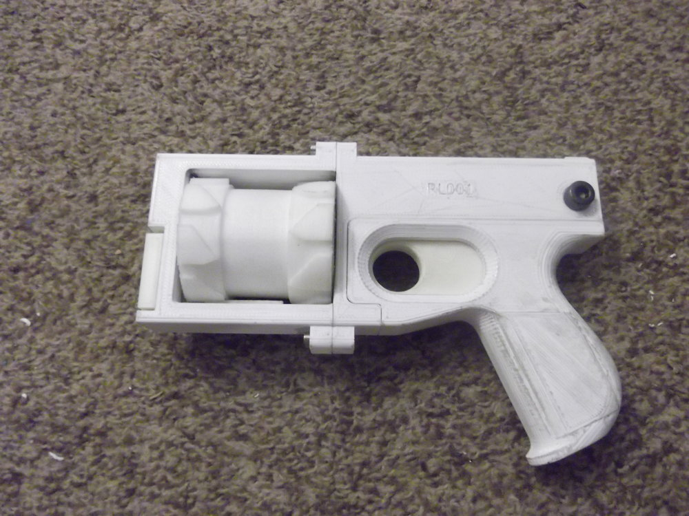 "3D printed ""washbear"" pistol uploaded by imgur user zimirken. The gun is printed from a combination of Nylon and PLA. The cylinders each contain a rifled stainless steel insert which supports the cartridge and bullet for half the length before transitioning to rifled nylon. It fires a .22 long rifle cartridge."