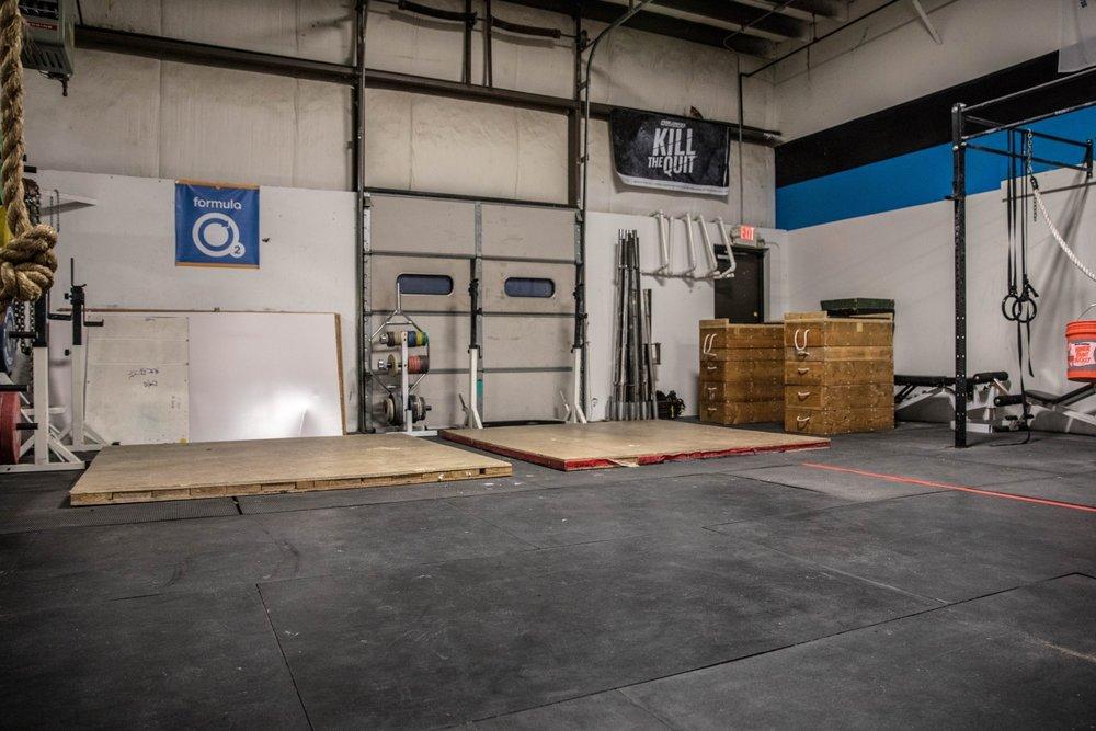 Romeo Athletics Gym Facility Large Room Space Barbells Racks.jpg