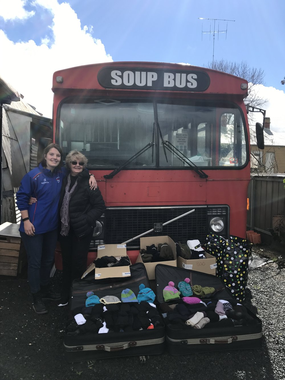 Amy with a member from the Ballarat SoupBus to accept our donation of over 1500+ socks from our 2017 Care Drive, the predecessor to Socks of the West.
