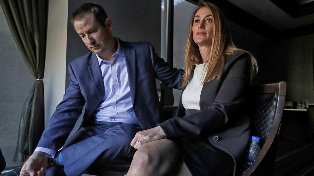 The parents of Blaze Bernstein, Gideon and Jeanne Pepper Bernstein during a marathon of interviews at a Costa Mesa business club. (Robert Gauthier / Los Angeles Times)