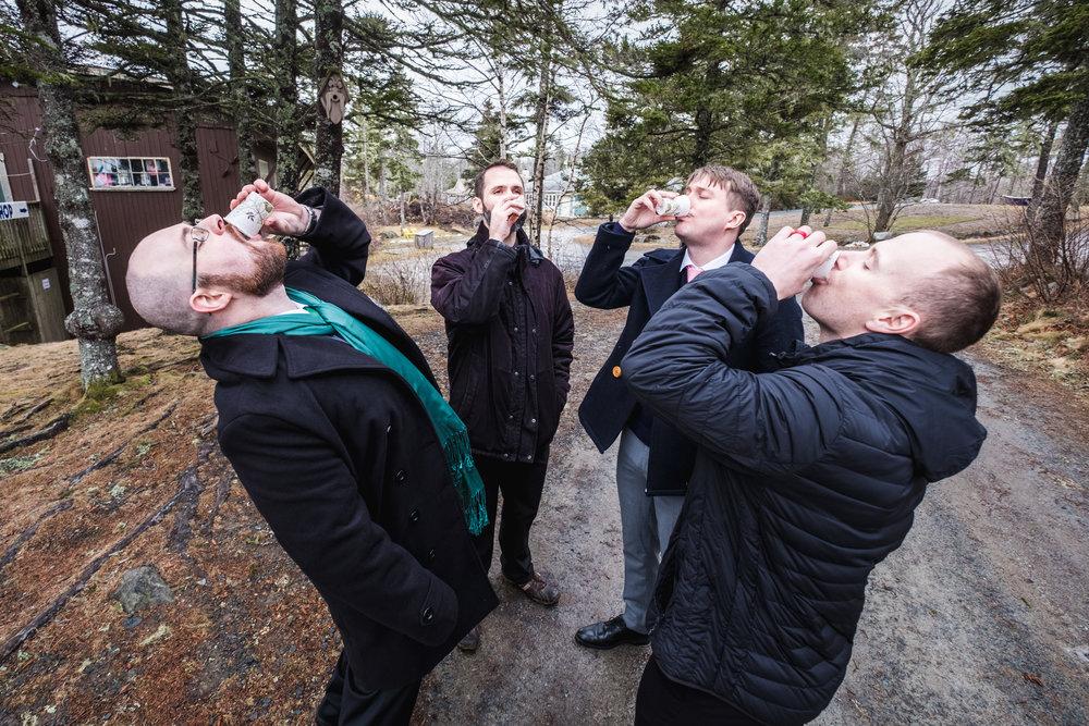boys-groomsmen-drink-winter