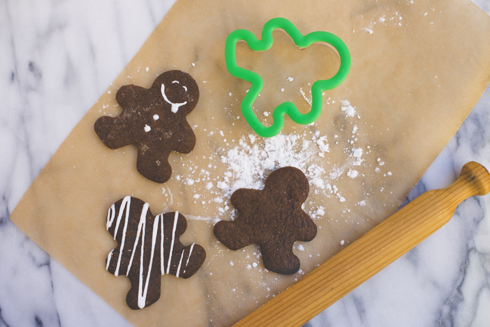 Gingerbread Men Flatlay on Parchment.png