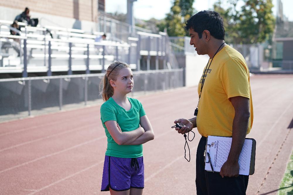 Dylan (Kyla Kenedy) and her Coach (Jay Chandrasekhar)