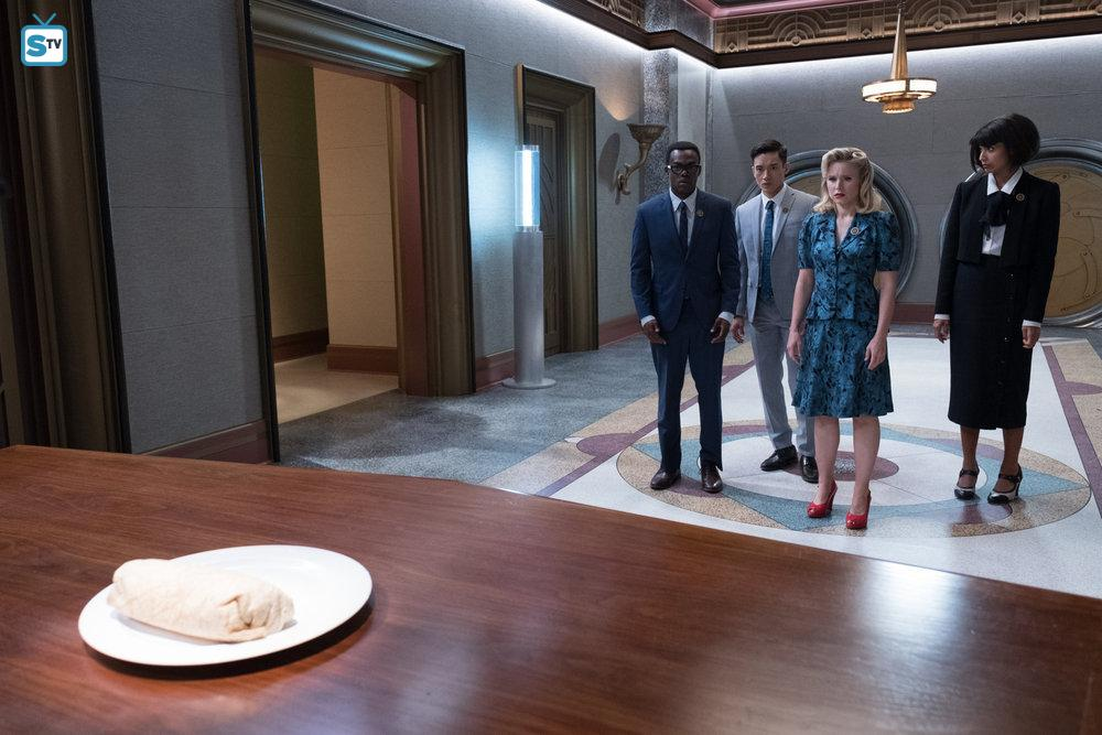 Chidi (William Jackson Harper), Jason (Manny Jacinto), Eleanor (Kristen Bell), and Tahani (Jameela Jamil) approach the Judge's desk