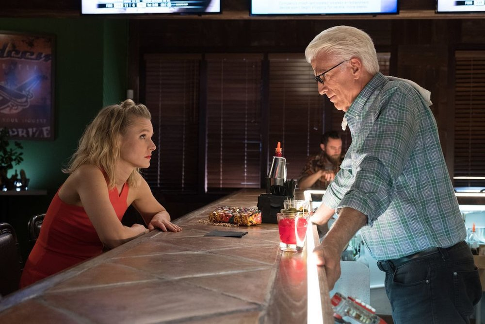 Michael and Eleanor (Kristen Bell) have a talk at a bar