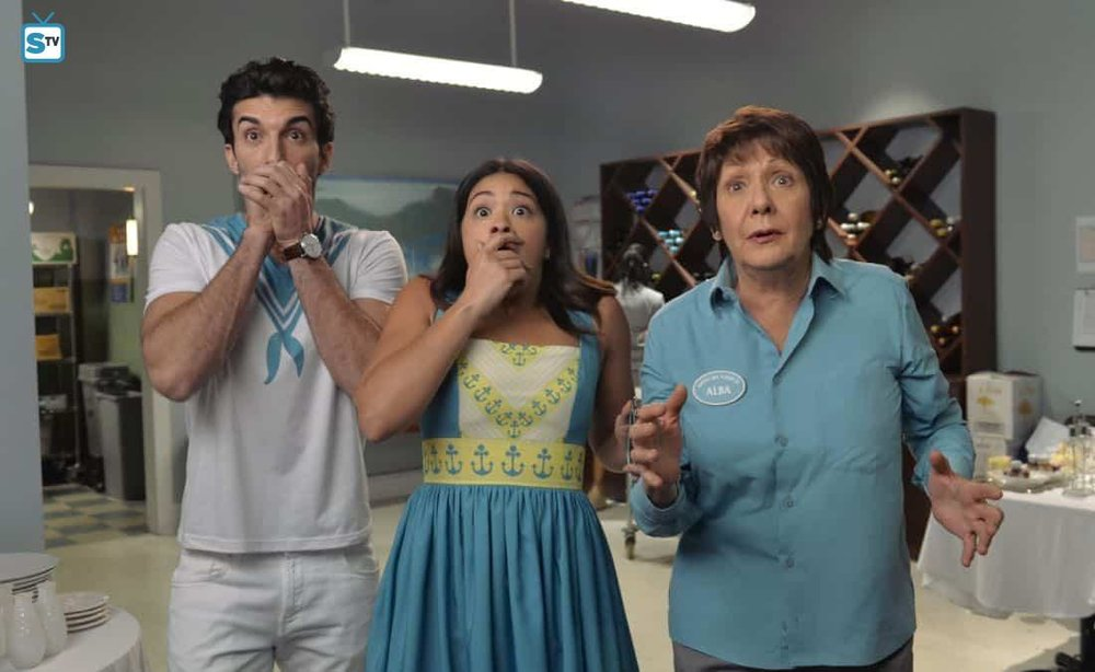 Rafael (Justin Baldoni), Jane (Gina Rodriguez), and Alba (Ivonne Coll) watch in horror as events on  The Talk  go awry.