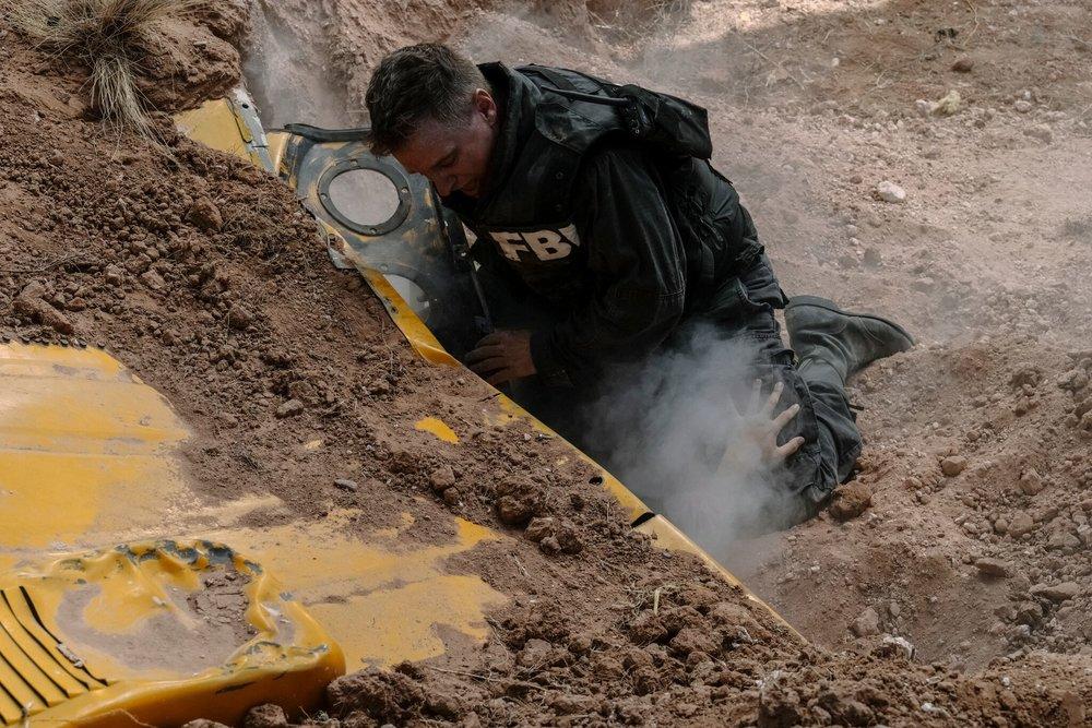 Decker digging for survivors
