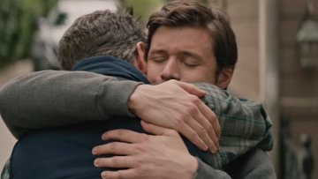 An emotional hug between Simon and his father, Jack Spier, played by Josh Duhamel