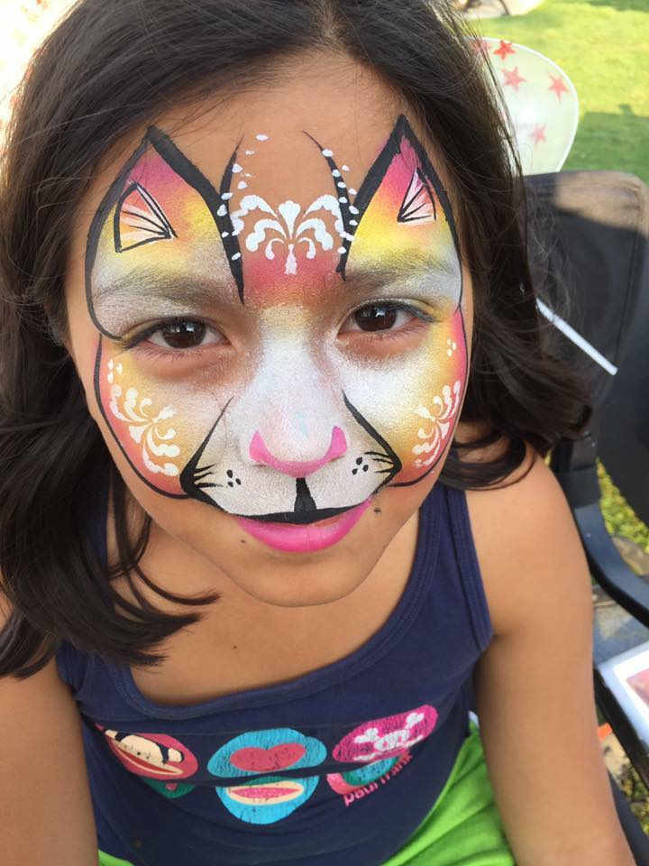 Colored cat with Lifes a Party Facepainting.jpg