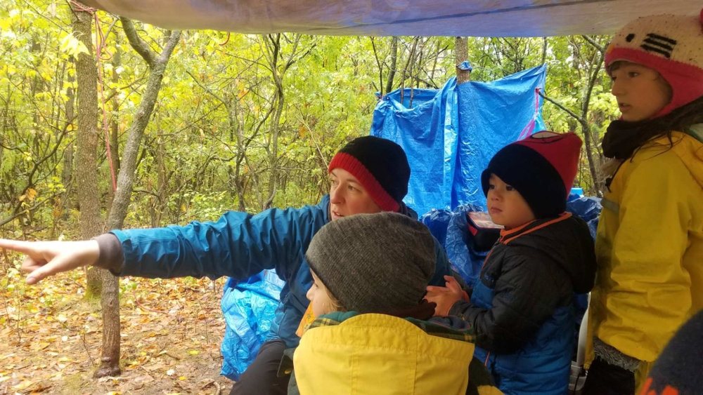 Founder & Executive Director, Bethany Beaudry observing wildlife with some learners in the outdoor classroom