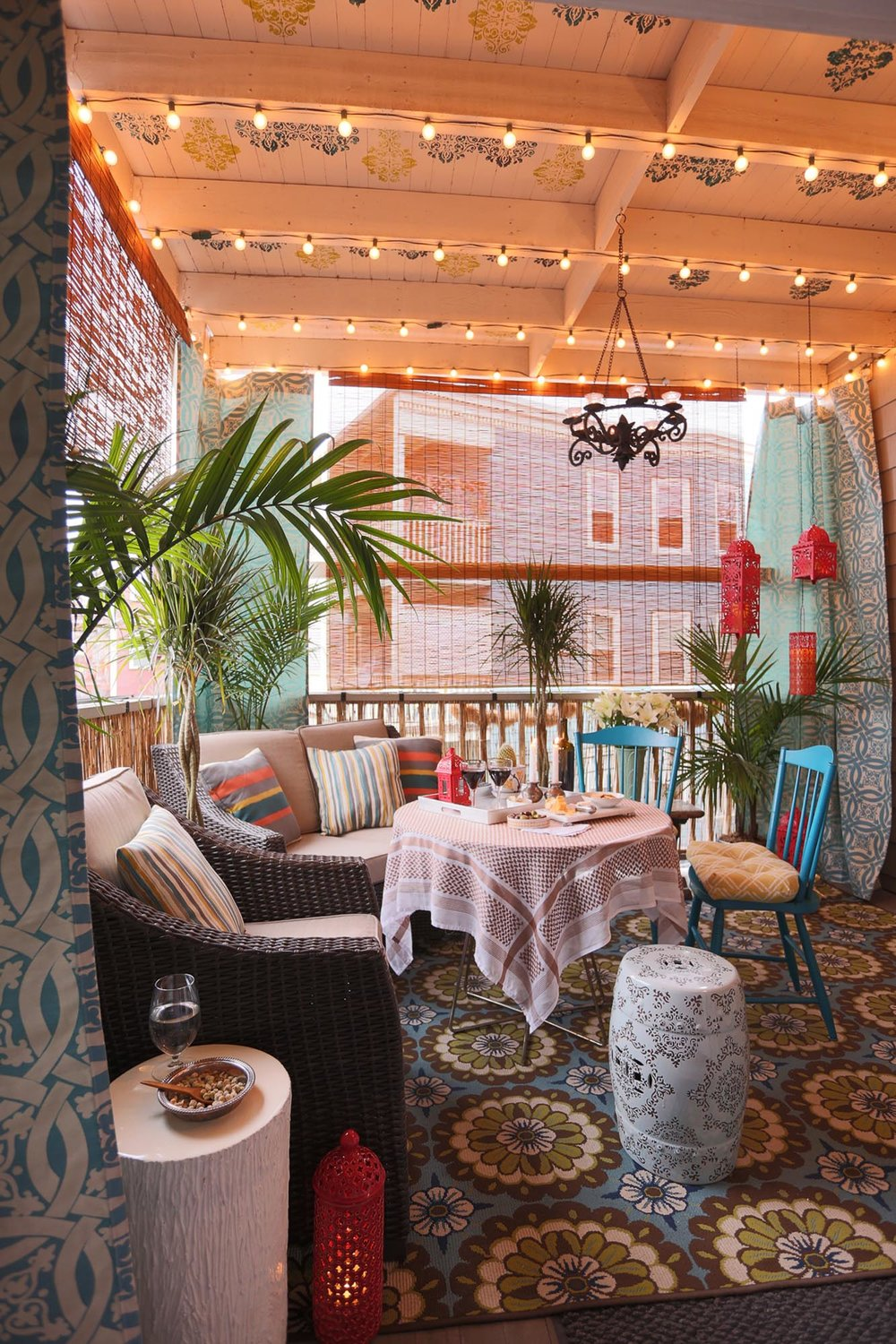 Balcony with floral carpet floor and stylish ceiling with lights.