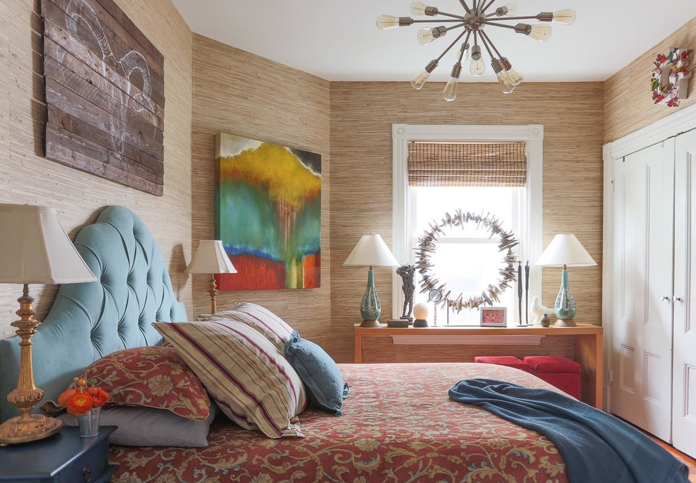 Wooden walled design bedroom with desk lamps and stylish chandelier on the ceiling.