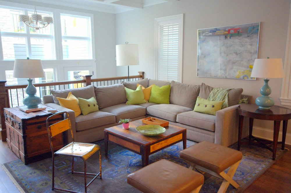 Family Friendly Living Room with light brown large sofa and wooden coffee table
