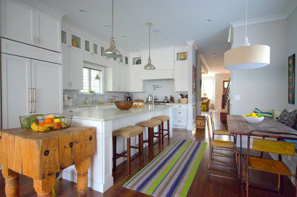 Family Kitchen design with white interior, granite counter top and stylish overhead light