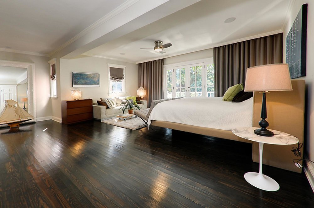 Spacious Master Bedroom design with living room and wooden flooring