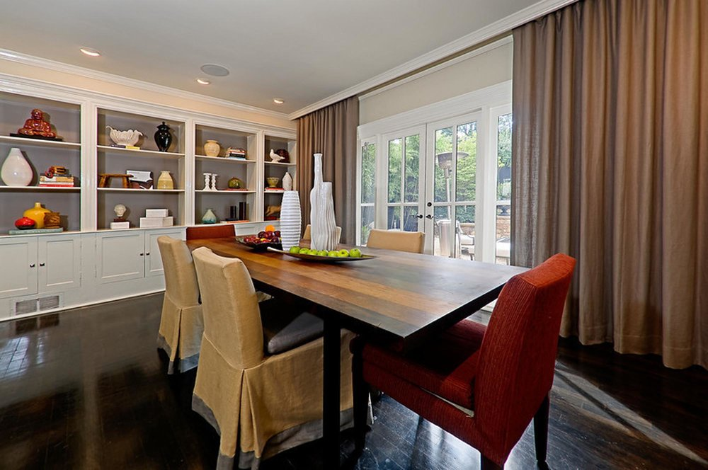 Dining Area with rectangular dining table for six, shelves with storage and large window.