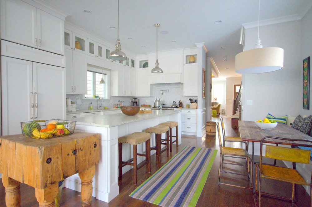 Modern style kitchen area with antique table and chairs