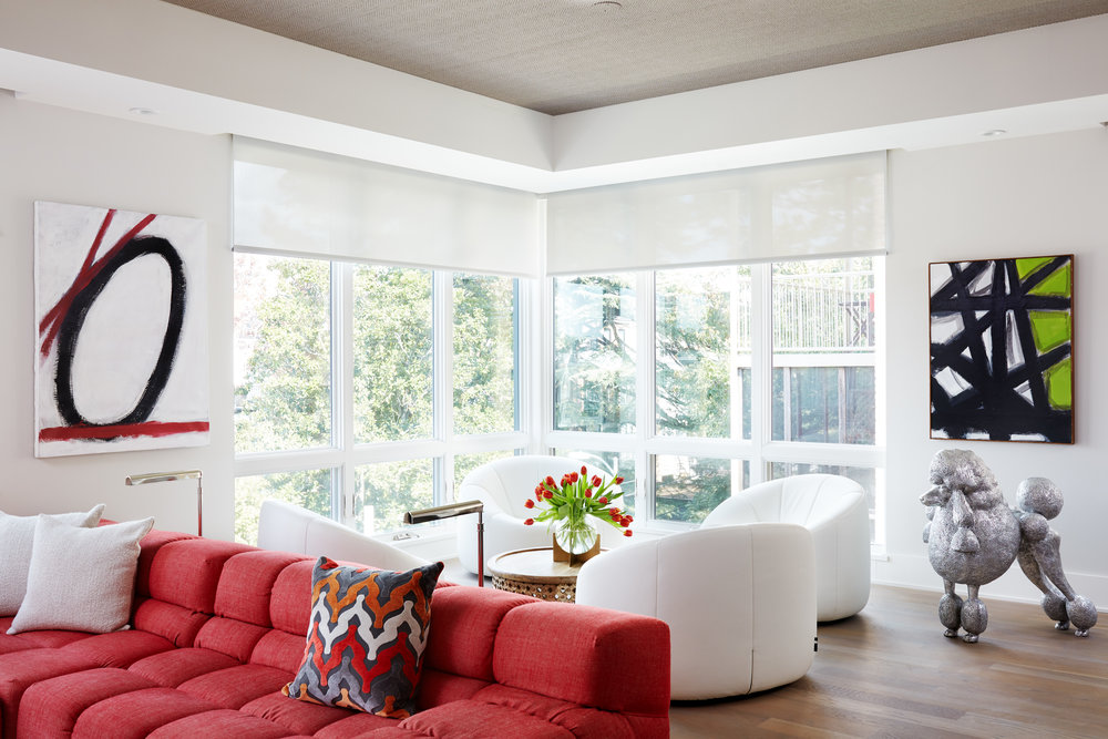 Living Room Design with white couch set and large red sofa