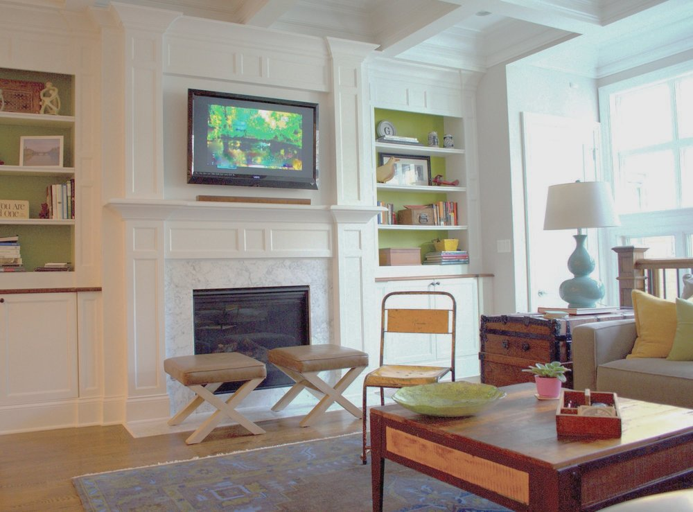 Living Room design with television set and bookshelves