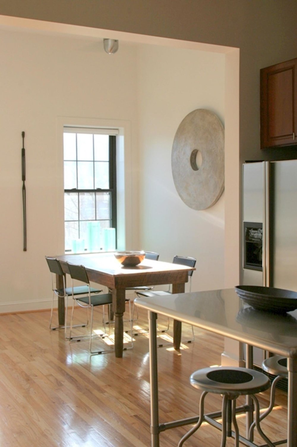 Dining area with rectangular table for four and high glass window