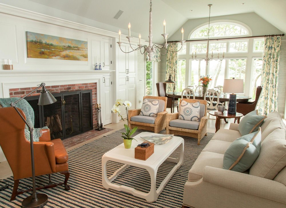 Living Room design with stripe rug, chandelier and fireplace overlooking dining area
