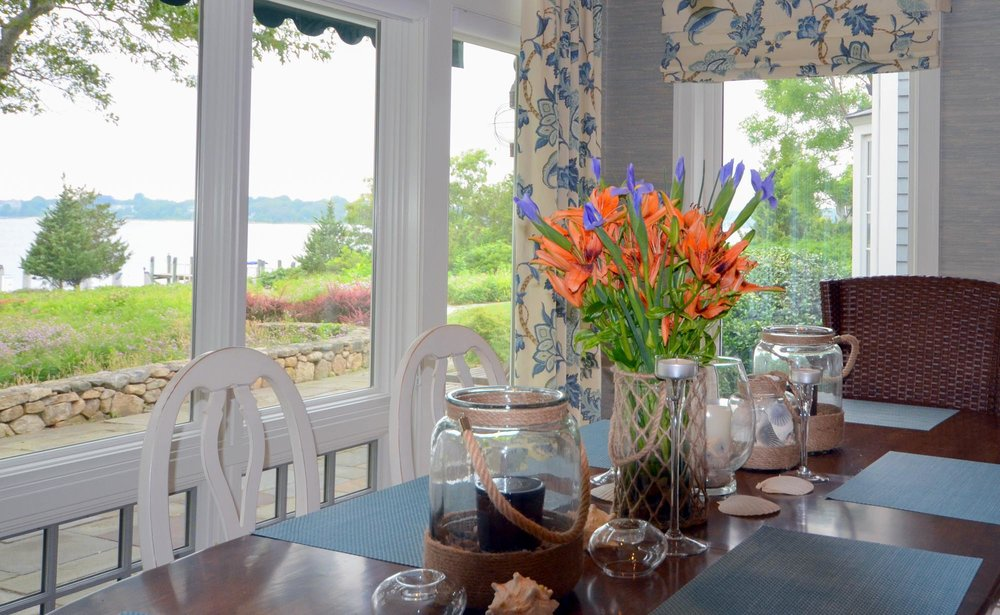Dining Room with large glass window overlooking the bay