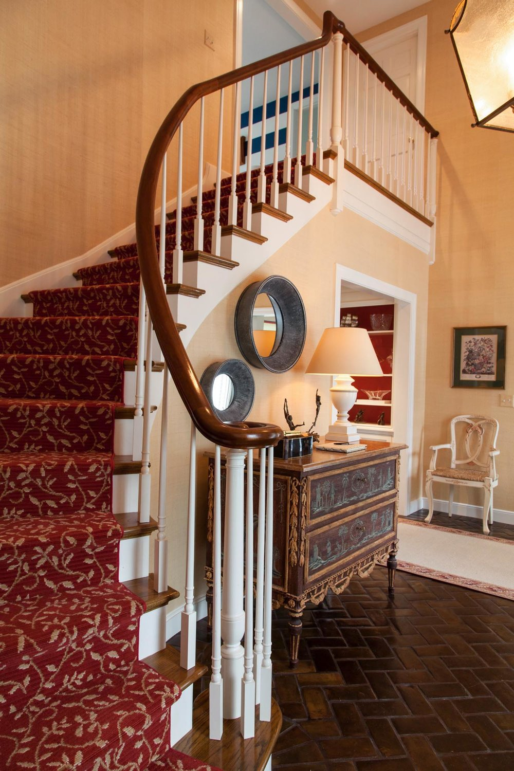 Wooden Staircase with carpet and wooden handrails