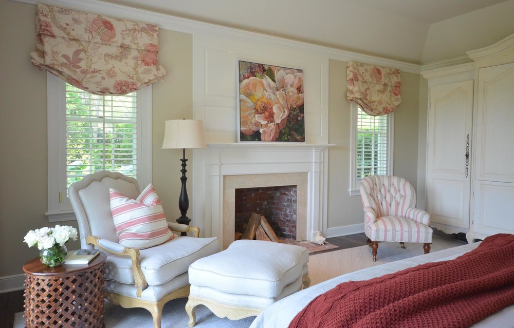 Bedroom Design with arm chairs and fireplace