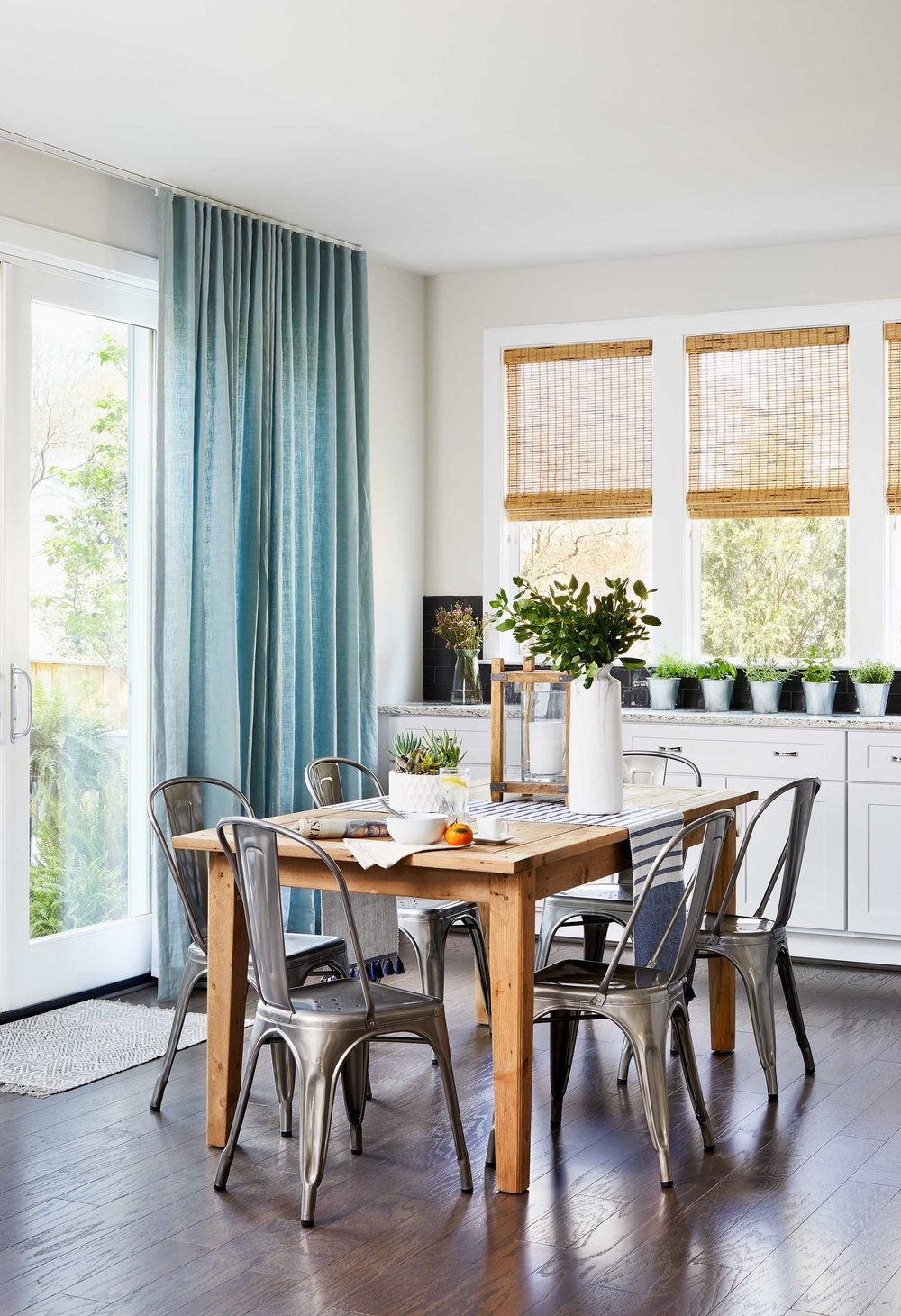 Small wooden breakfast table with metal chairs