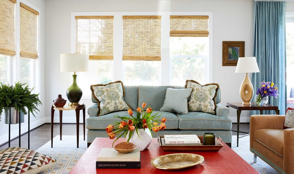 Bright living room with tan rolling shades