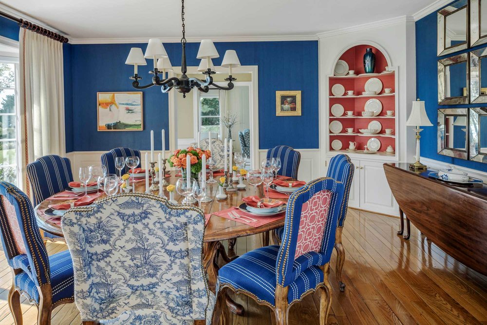 Dining room with royal blue walls and chairs