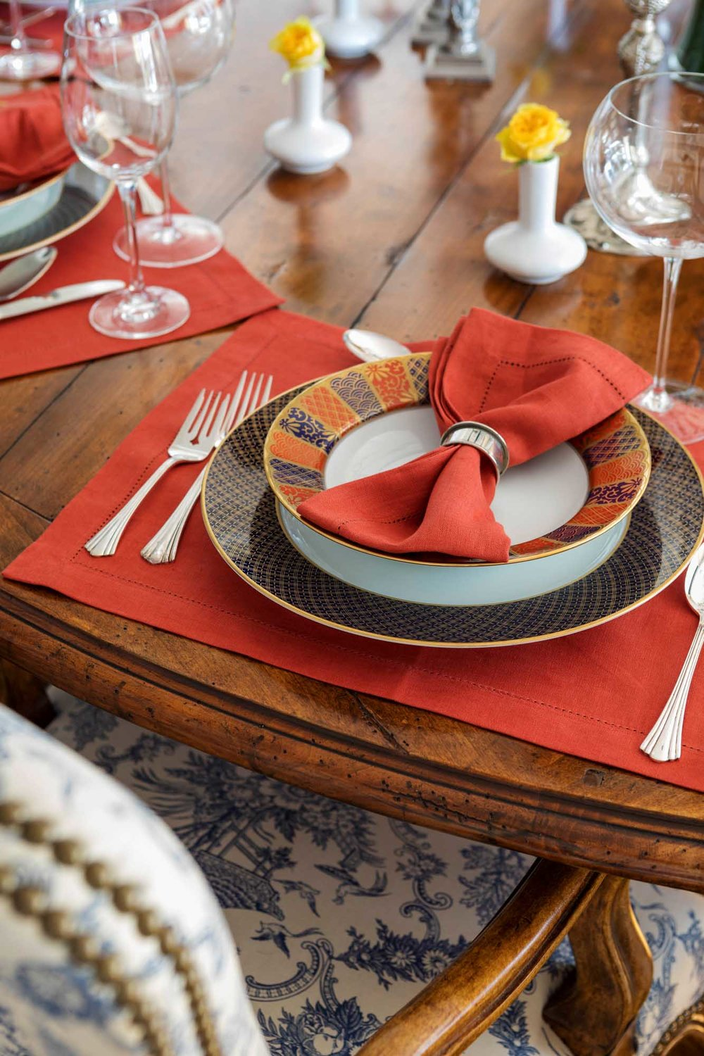 Red place settings on wooden dining table