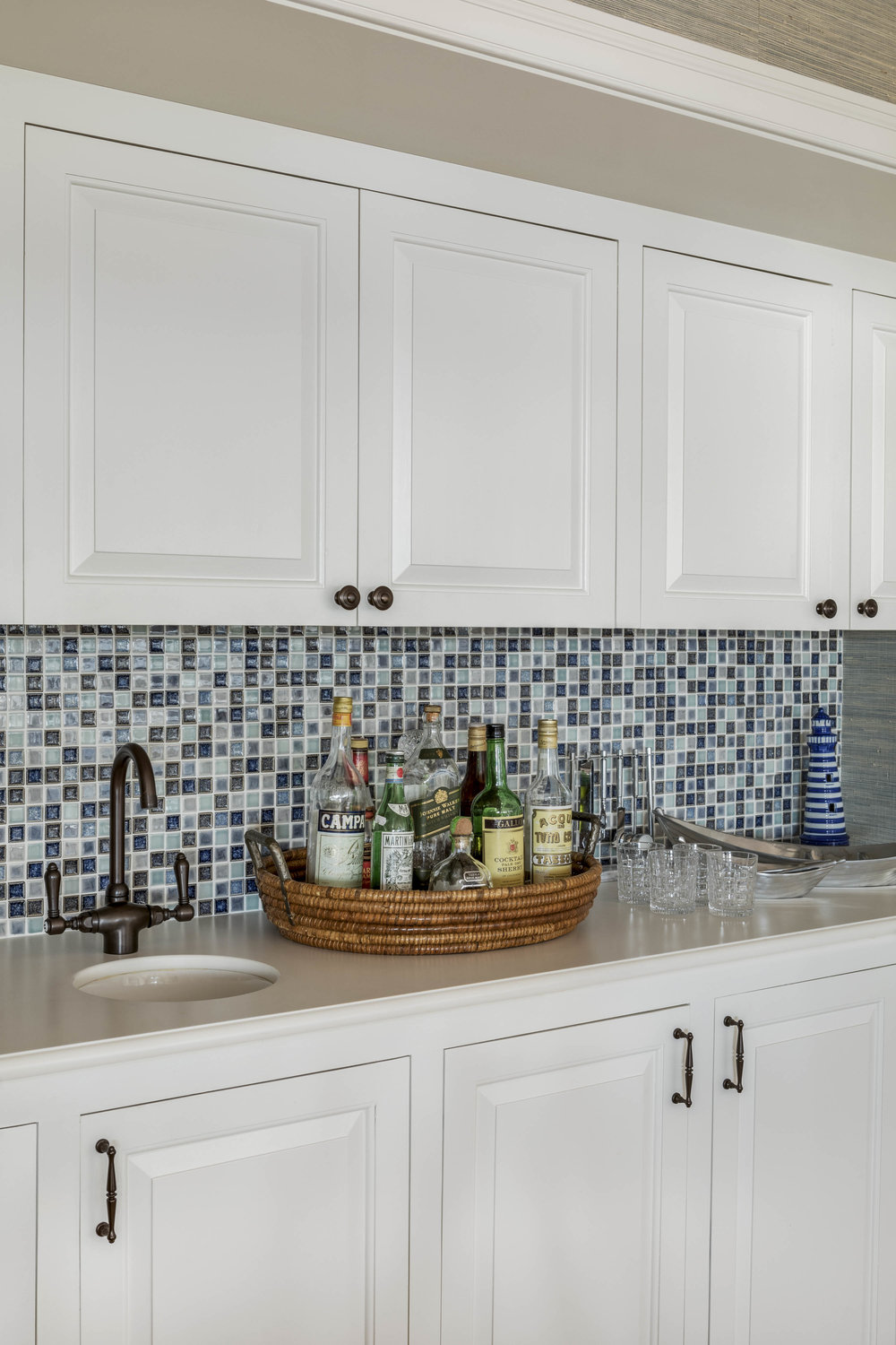 Bar area with blue and white tiled backsplash