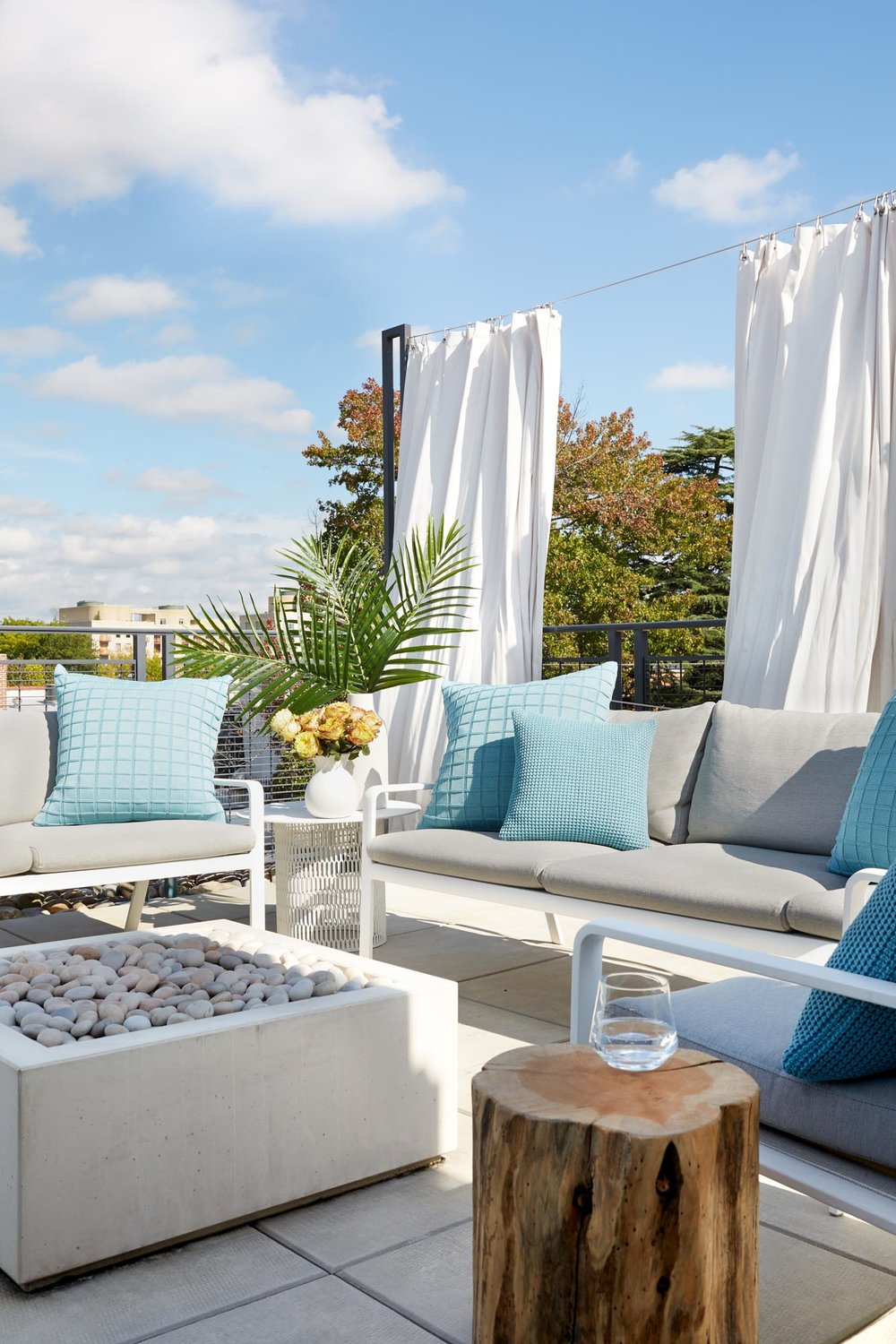 Rooftop patio with light furnishings