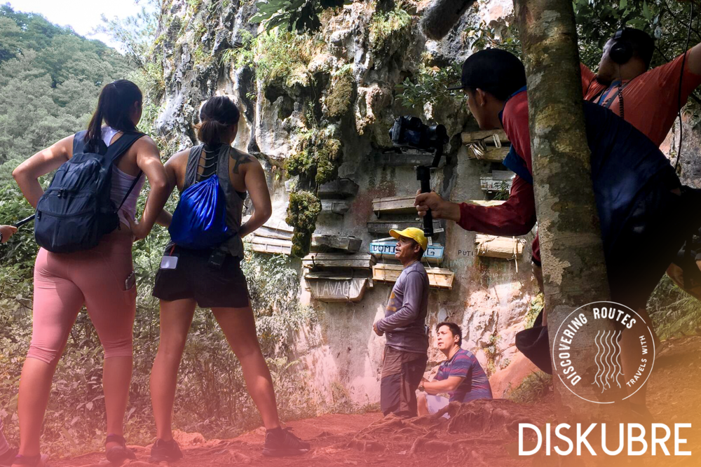 """Elaine Ficarra and Alex Brown take in the sight of the hanging coffins of Sagada. According to    www.roughguides.com   , """"members of the Igorot tribe of Mountain Province in northern Philippines have long practiced the tradition of burying their dead in hanging coffins, nailed to the sides of cliff faces high above the ground."""""""