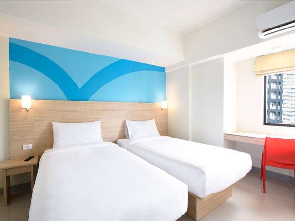A typical room at Hop Inn  Aseana