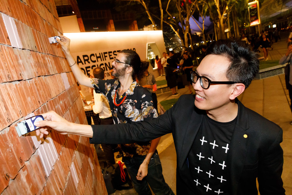 Festival Director Mr Yann Follain (L) and President of SIA Mr Seah Chee Huang (R) painting the Walls of Connection mural wall, contributing to a visual representation of Singapore's Rochor Centre
