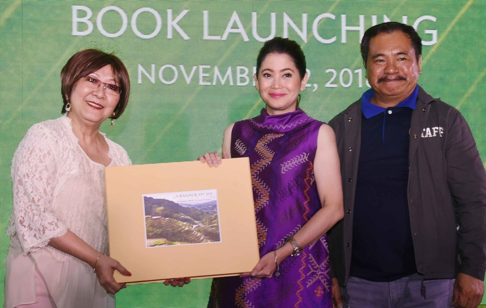 """Dr. Milagros O. How presenting the """"A Banaue Story"""" book to special guest during the launch, DOT Secretary Bernadette Romulo-Puyat    together with Banaue Mayor Jerry U. Dalipog"""