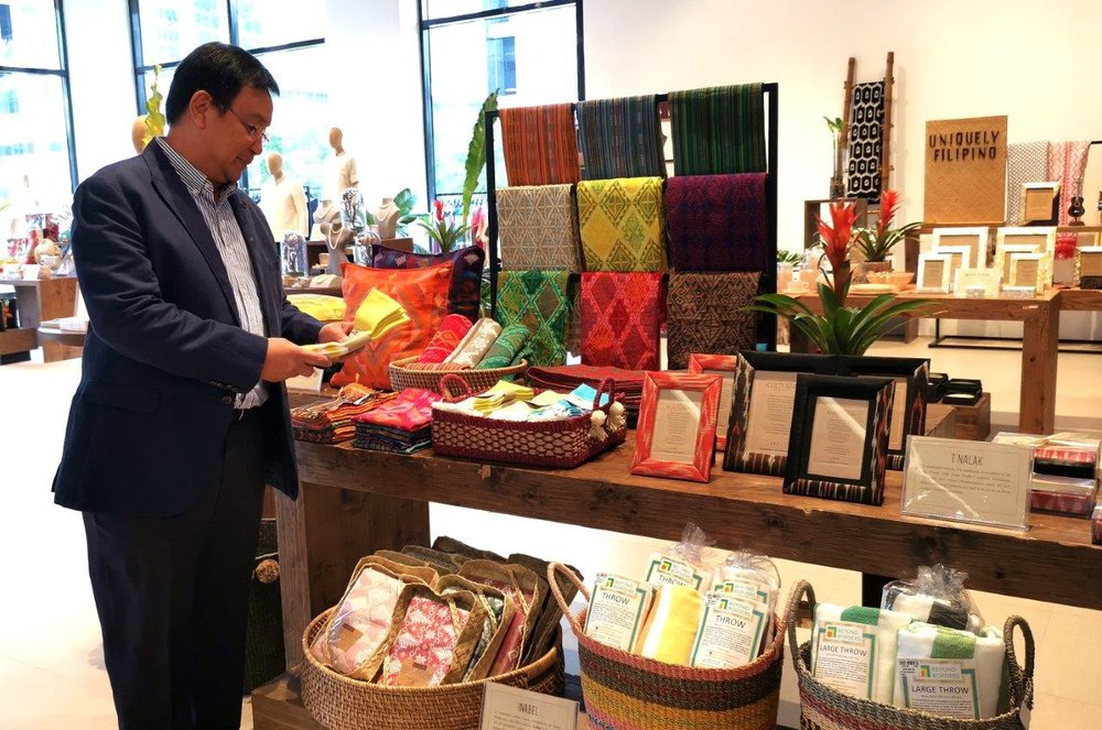 DFPC COO Vicente Pelagio Angala browses Philppine made products now in duty free stores