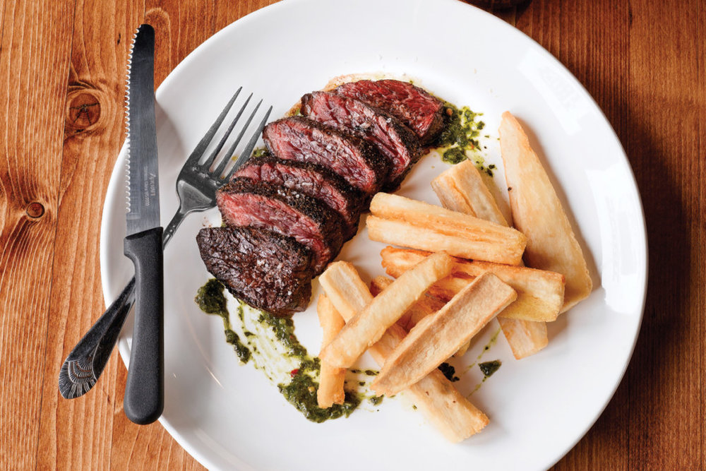 Grilled hanger steak, yucca fries and chimichurri. Photography by Angel Tucker.