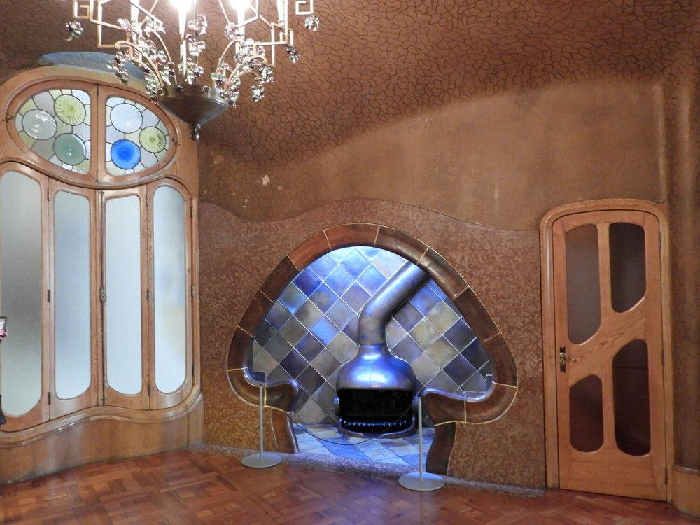spain-barcelona-batllo-entry-fireplace-interior.jpg